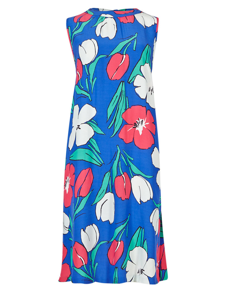 """""""This bold, floral dress takes me back to the Sixties - the swing silhouette is so flattering! I'll be wearing it to all my summer events, from weddings to garden parties and I'm even thinking of wearing it to the Chelsea Flower Show"""""""